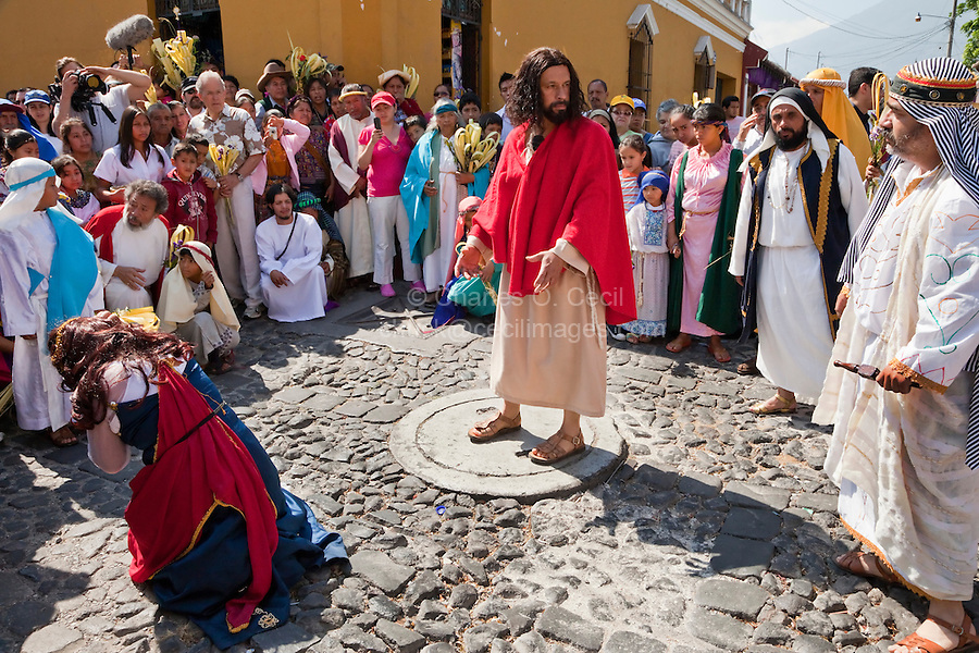 Jesus Challenges the Pharisee to Cast the First Stone against the Woman Caught in Adultery.  (John 8:1-11)  Palm Sunday Re-enactment of events in the life of Jesus, by the group called Luna LLena (Full Moon), a group of volunteers in Antigua, Guatemala.