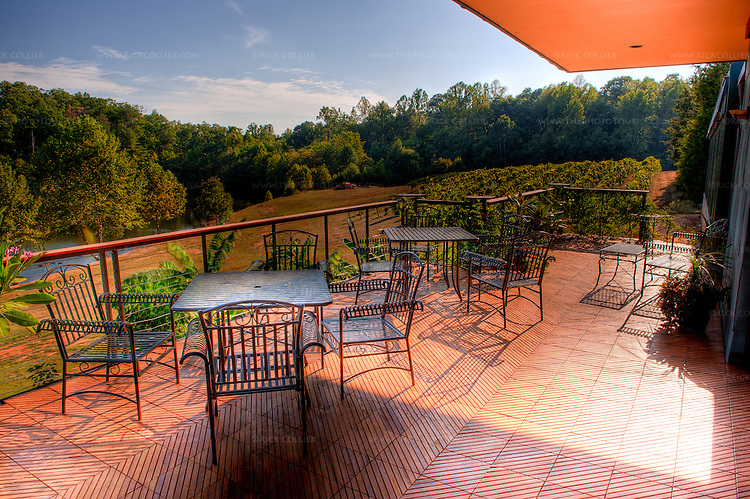 The deck at Glass House Winery is finished in exotic hardwood tiles and offers views of vineyards and pond beyond.  (HDR image -- Glass House Winery, Free Union VA.)