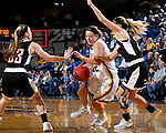 BROOKINGS, SD - JANUARY 7:  Sydney Palmer #32 from South Dakota State drives past Ellie Brecht #34 from the University of Nebraska Omaha during their game Saturday afternoon at Frost Arena in Brookings. (Dave Eggen/Inertia)