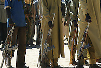 an SLA ( sudan liberaration army) suares up at the Amsiala base not far from Kuthum in north Dardfur on Dec 2004.