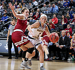 SIOUX FALLS, SD: MARCH 4: Emily Clemens #2 from Western Illinois drives against Jacqlyn Poss #12 from Denver on March 4, 2017 during the Summit League Basketball Championship at the Denny Sanford Premier Center in Sioux Falls, SD. (Photo by Dave Eggen/Inertia)