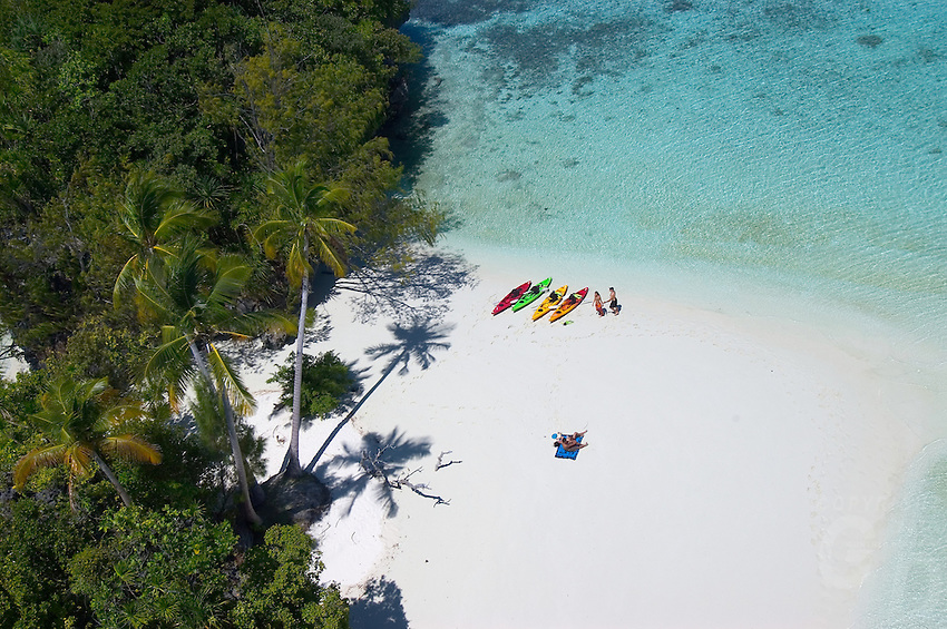 The famous three Coconut island from the air,with some Kayaks and people,Palau,Micronesia