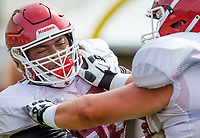 NWA Democrat-Gazette/BEN GOFF @NWABENGOFF<br /> Brian Wallace, Arkansas offensive lineman, works a drill Wednesday, Aug. 8, 2018, at the Arkansas practice field in Fayetteville.