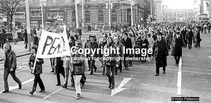 Peace March, organised by students at Queen's University, Belfast, N Ireland, 13th December 1972, arriving at the front of the City Hall. A meeting in the City Hall Grounds was addressed by Ballymena surgeon, John Robb, and Rev Joseph Parker who founded the Witness for Peace Movement following the death of his son, Stephen Parker, on Bloody Friday, 21 July 1972, 26 bombs exploded in the space of 80 minutes killing eleven people, including two British soldiers, and injuring 130. 197212130811a<br /> <br /> Copyright Image from Victor Patterson, 54 Dorchester Park, <br /> Belfast, UK, BT9 6RJ<br /> <br /> t1: +44 28 9066 1296 (from Rep of Ireland 048 9066 1296)<br /> t2: +44 28 9002 2446 (from Rep of Ireland 048 9002 2446)<br /> m: +44 7802 353836<br /> <br /> e1: victorpatterson@me.com<br /> e2: victorpatterson@gmail.com<br /> <br /> www.victorpatterson.com<br /> <br /> Please see my Terms and Conditions of Use at www.victorpatterson.com. It is IMPORTANT that you familiarise yourself with them.<br /> <br /> Images used on the Internet must be visibly watermarked i.e. &copy; Victor Patterson within the body of the image and copyright metadata must not be deleted. Images used on the Internet have a size restriction of 4kbs and will be chargeable at current NUJ rates unless agreed otherwise.<br /> <br /> This image is only available for the use of the download recipient i.e. television station, newspaper, magazine, book publisher, etc, and must not be passed on to any third party. It is also downloaded on condition that each and every usage is notified within 7 days to victorpatterson@me.com<br /> <br /> The right of Victor Patterson to be identified as the author is asserted in accordance with The Copyright Designs And Patents Act (1988).
