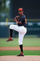 GCL Orioles pitcher Ofelky Peralta (35) delivers a pitch during the first game of a doubleheader against the GCL Rays on August 1, 2015 at the Ed Smith Stadium in Sarasota, Florida.  GCL Orioles defeated the GCL Rays 2-0.  (Mike Janes/Four Seam Images)