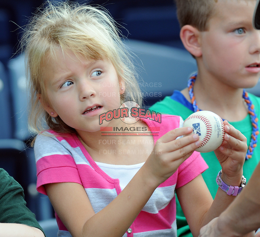A young fan of the Greenville Drive waits patiently for a player autograph prior to a game against the Rome Braves on August 16, 2011, at Fluor Field at the West End in Greenville, South Carolina. (Tom Priddy/Four Seam Images)