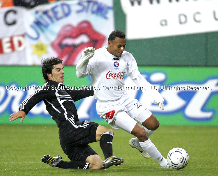 01 March 2007: DC United's Facundo Erpen (left) slides in to challenge Olimpia's Sergio Mendoza (23). DC United defeated CD Olimpia of Honduras 3-2 at RFK Stadium in Washington DC in the second leg of a CONCACAF Champions Cup quarterfinal competition.  DC United advanced by an aggregate score of 7-3.