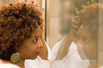 African American woman looking at her reflection