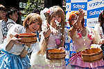 Cosplayers sprinkle water during the ''Uchimizukko Big Gathering Festival'' in Akihabara electric district of Tokyo, Japan on August 23, 2015. About 21 groups from Akihabara including maid cafes' waitresses and cosplayers attended the event, which included for the first time an official mascot character ''2C Chan.'' This year is the 12th anniversary of the event which began as a way to reduce dust and cool pavements in the Akihabara area. Uchimizukko is a Japanese summer tradition. (Photo by Rodrigo Reyes Marin/AFLO)