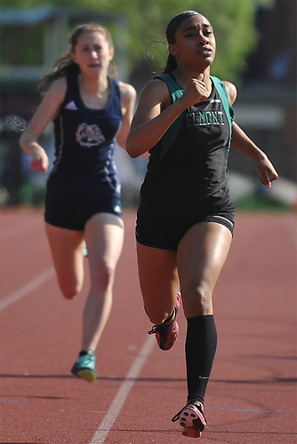 Brianna Harris of Elmont legs out a victory in the girls' 400 meter race during the Nassau County AA track & field championship at MacArthur High School on Wednesday, May 23, 2018.