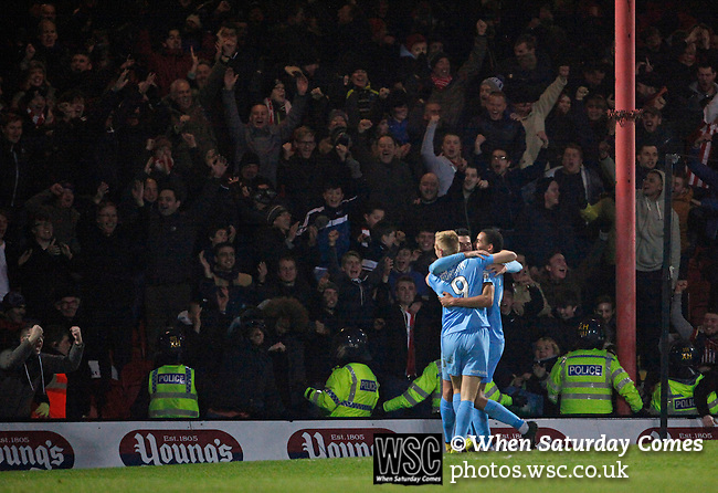 Grimsby Town 1 Lincoln City 3, 28/12/2014. Blundell Park, Football Conference. Goal celebration Lincoln City's Marcus Marshall and Jordan Burrow celebrate Alan Power's goal.  Photo by Paul Thompson.