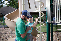 Jonathan Hutchins (from left) and Matthew Hutchins, 4, play, Saturday, August 1, 2020 at a park on Sunrise Dr. in Bethel Heights. Voters in Springdale and Bethel Heights will determine August 11 if Springdale will annex its neighbor to the north. Check out nwaonline.com/200802Daily/ for today's photo gallery. <br /> (NWA Democrat-Gazette/Charlie Kaijo)