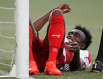 Joe Dodoo holds his leg after suffering an injury