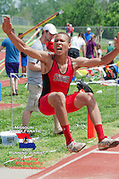 Fort Zumwalt South sophomore Marquel Harris gets stretches toward the sand pit in the boys long jump at the Class 4 Sectional 2 meet where he finished second with a best mark of 21-0.5.