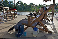 A traveler enjoys her afternoon lemonade at Marasha Lodge/Reserve - Amazonas - Peru