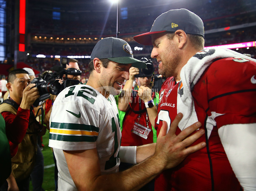 Dec 27, 2015; Glendale, AZ, USA; Arizona Cardinals quarterback Carson Palmer (right) greets Green Bay Packers quarterback Aaron Rodgers following the game at University of Phoenix Stadium. Mandatory Credit: Mark J. Rebilas-USA TODAY Sports