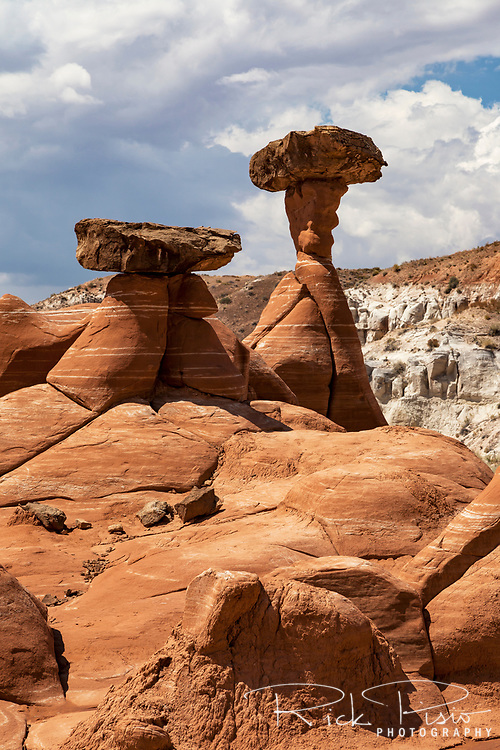 Toadstool formation in Grand Staircase Escalante National Monument. The toadstools are formed when a Dakota Sandstone boulder causes the underlying Entrada Sandstone layer to erode at a slower pace directly beneath it, forming a spire.