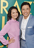 HOLLYWOOD, CA - AUGUST 07: Jae Suh Park (L) and Randall Park arrive at the Warner Bros. Pictures' 'Crazy Rich Asians' premiere at the TCL Chinese Theatre IMAX on August 7, 2018 in Hollywood, California.<br /> CAP/ROT/TM<br /> &copy;TM/ROT/Capital Pictures