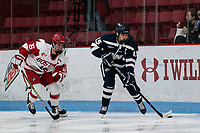 BOSTON, MA - FEBRUARY 16: Tori Howran #15 of University of New Hampshire brings the puck forward as Sammy Davis #16 of Boston University closes during a game between University of New Hampshire and Boston University at Walter Brown Arena on February 16, 2020 in Boston, Massachusetts.