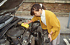 Woman filling car with oil,