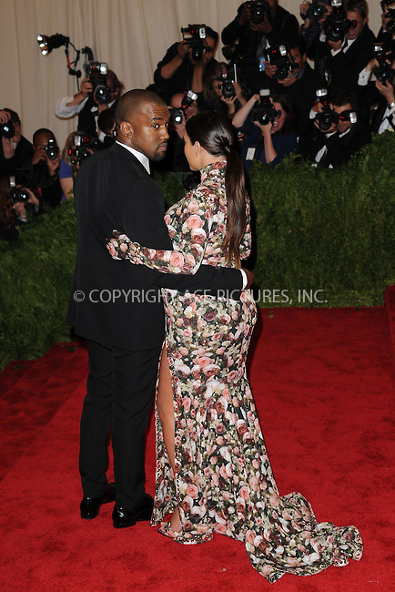WWW.ACEPIXS.COM . . . . . .May 6, 2013...New York City....Kanye West and Kim Kardashian attending the PUNK: Chaos to Couture Costume Institute Benefit Gala at The Metropolitan Museum of Art in New York City on May 6, 2013  in New York City ....Please byline: Kristin Callahan...ACEPIXS.COM...Ace Pictures, Inc: ..tel: (212) 243 8787 or (646) 769 0430..e-mail: info@acepixs.com..web: http://www.acepixs.com .