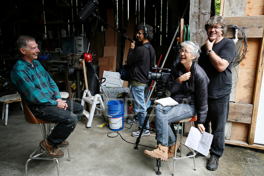 Tom Chudleigh of Free Spirit Spheres and the Branche Arbre film crew have a laugh in Qualicum Beach, British Columbia. Production film stills photo assignment for Red Letter Films.