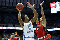 CHAPEL HILL, NC - NOVEMBER 01: Armando Bacot #5 of the University of North Carolina takes a jump shot over Andrew Lopez #5 of Winston-Salem State University during a game between Winston-Salem State University and University of North Carolina at Dean E. Smith Center on November 01, 2019 in Chapel Hill, North Carolina.