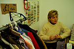 Unemployed woman living on benefits doing a second in a second hand used clothes  one pound £1.00 shop. 1998 1990s  UK Mountain Ash Wales