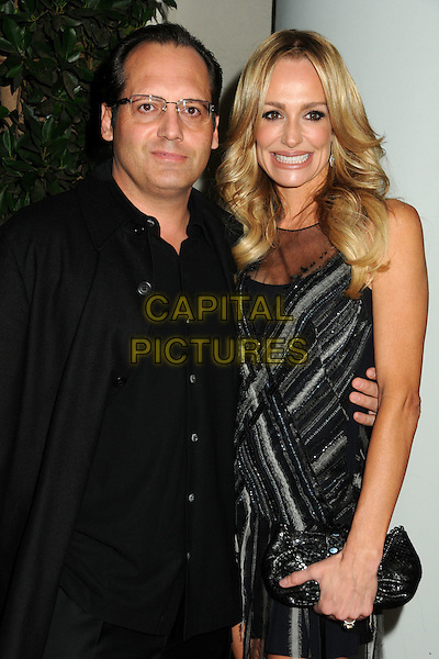 GUEST & TAYLOR ARMSTRONG.TV Guide Magazine's 2010 HOT LIST Party held at Drai's at the W Hotel, Hollywood, California, USA.November 8th, 2010.half length dress black  sheer clutch bag suit jacket glasses .CAP/ADM/BP.©Byron Purvis/AdMedia/Capital Pictures.
