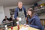 © Joel Goodman - 07973 332324 . . 07/02/2014 .  Manchester , UK . David Neilson , who plays Roy Cropper in Coronation Street , serves tea to Amy Derraven from Wigan at Jackie's Cafe in Northern Moor . David is showing his support for Mike Kane in the Wythenshawe and Sale byelection campaign trail . Photo credit : Joel Goodman