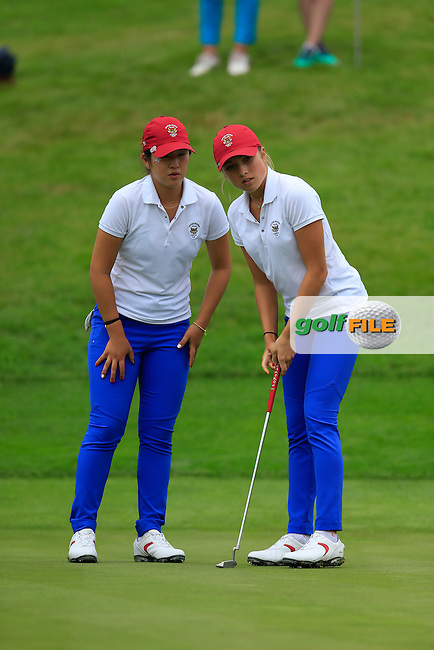 Bailey Tardy and Monica Vaughn on the 18th during the Saturday morning foursomes at the 2016 Curtis cup from Dun Laoghaire Golf Club, Ballyman Rd, Enniskerry, Co. Wicklow, Ireland. 11/06/2016.<br /> Picture Fran Caffrey / Golffile.ie<br /> <br /> All photo usage must carry mandatory copyright credit (&copy; Golffile | Fran Caffrey)