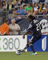 New England Revolution midfielder Shalrie Joseph (21) at midfield. In a Major League Soccer (MLS) match, the New England Revolution tied New York Red Bulls, 2-2, at Gillette Stadium on August 20, 2011.