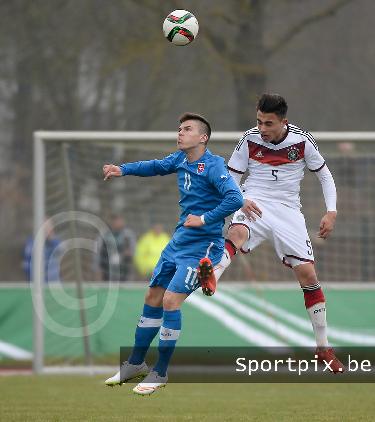 20150321 - Wetzlar , GERMANY  : German Erdinc Karakas (right) pictured in a heading duel with Slovakian Lubomir Tupta (left)  during the soccer match between Under 17 teams of Germany and Slovakia , on the first matchday in group 8 of the UEFA Elite Round Under 17 at Stadion Wetzlar , Wetzlar Germany . saturday 21 th March 2015 . PHOTO DAVID CATRY