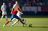 Sebastian Lletget #17 of the United States and Yeltsin Tejeda #17 of Costa Rica fight for a ball