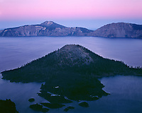 ORCL_070 - USA, Oregon, Crater Lake National Park, View eastward reveals glow of evening twilight sky over Crater Lake with nearby Wizard Island and distant Mount Scott.