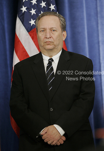 Chicago, IL - November 24, 2008 -- United States National Economic Council Director-designate Lawrence Summers stands at a news conference where President-elect Barack Obama introduced his economic team on Monday, November 24, 2008 in Chicago. Obama also introduced Treasury Secretary-designate Timothy Geithner, Council of Economic Advisers Chair-designate Christina Romer and White House Domestic Policy Council Director-designate Melody Barnes. .Credit: Brian Kersey - Pool via CNP
