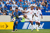 El Salvador midfielder Darwin Ceren (7) and Trinidad and Tobago midfielder Denzil Theobald (18) during a CONCACAF Gold Cup group B match at Red Bull Arena in Harrison, NJ, on July 8, 2013.
