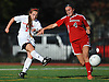 Sacred Heart No. 2 Caitlin Kennedy, left, takes a shot that found the back of the net in the ninth minute of a CHSAA varsity girls' soccer game against St. John the Baptist at Sacred Heart Academy on Monday, October 5, 2015. She scored all three of her team's goals in Sacred Heart's 3-1 win.<br /> <br /> James Escher