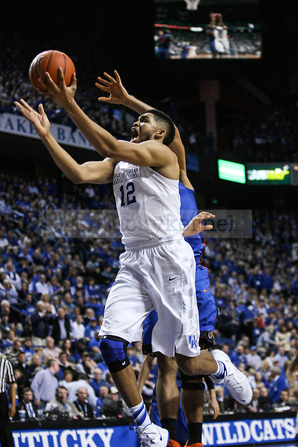 Kentucky forward Karl-Anthony Towns lobs the ball towards the net during the second half of the Kentucky vs. Florida game at Rupp Arena in Lexington, Ky.,on Saturday, March 7, 2015. UK defeated Florida 67-50, completing a perfect regular season. Photo by Adam Pennavaria | Staff