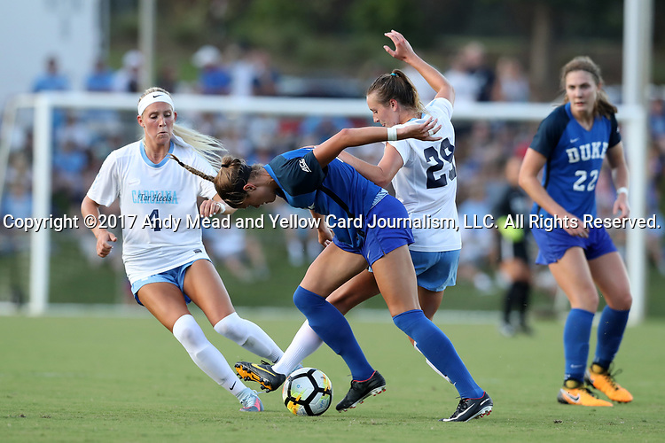 CARY, NC - AUGUST 18: Duke's Chelsea Burns (left) and North Carolina's Dorian Bailey (29). The University of North Carolina Tar Heels hosted the Duke University Blue Devils on August 18, 2017, at Koka Booth Stadium in Cary, NC in a Division I college soccer game.