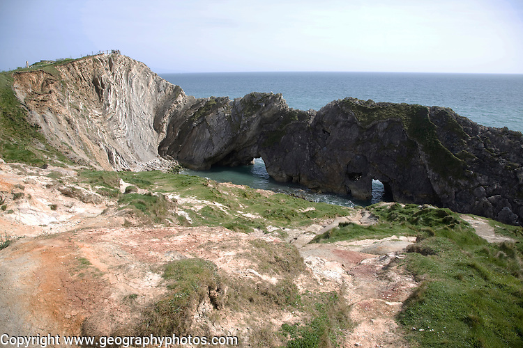 Caves in Portland limestone, folded Purbeck limestone of the Lulworth Crumple and slumping of Wealden strata of greensand and clay beds. Stair Hole, Lulworth, Dorset, England