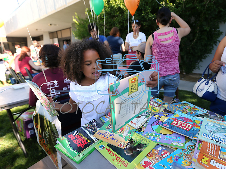 Clarissa Browne, 6, selects books at the Summer Reading Program Pancake Breakfast Kick-Off at the Carson City Library, in Carson City, Nev., on Saturday, June 8, 2013. <br /> Photo by Cathleen Allison