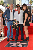 LOS ANGELES, CA. August 22, 2018: David Foster, Simon Cowell & Katharine McPhee at the Hollywood Walk of Fame Star Ceremony honoring Simon Cowell.