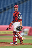 Clearwater Threshers catcher Corey Bass (23) walks to the mound during a game against the Brevard County Manatees on June 28, 2014 at Bright House Field in Clearwater, Florida.  Brevard County defeated Clearwater 6-4.  (Mike Janes/Four Seam Images)