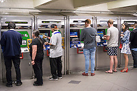 Customers at the MetroCard vending machines in the Columbus Circle station in the subway in New York on Tuesday, April 19, 2016. The MTA has announced plans to do away with the MetroCard and replace it with a more updated technology sometime in the future. (© Richard B. Levine)