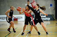 Action from the 2017 A Girls' Secondary Schools Basketball Premiership National Championship match between Stratford High School (red and black) and Ellesmere College (navy) at the B&M Centre in Palmerston North, New Zealand on Monday, 2 October 2017. Photo: Dave Lintott / lintottphoto.co.nz