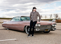 JR Hildebrand with his 1960 Cadillac Coupe de Ville named Rosie, in Boulder, Colorado, Friday, December 1, 2017. Hildebrand had the car restored just in time for his wedding, and earlier this year, strangers in his neighborhood saw it and asked if they could use it in their wedding. JR drove the couple, and they had no idea he's a professional IndyCar racing driver.<br /> <br /> Photo by Matt Nager
