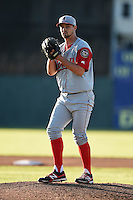 Lowell Spinners pitcher Reed Reilly (47) gets ready to deliver a pitch during a game against the Batavia Muckdogs on July 16, 2014 at Dwyer Stadium in Batavia, New York.  Lowell defeated Batavia 6-4.  (Mike Janes/Four Seam Images)