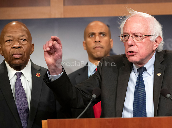 United States Senator Bernie Sanders (Independent of Vermont), right, makes remarks at a press conference in the US Capitol in Washington, DC announcing a Democratic package of three bills to be introduced in the US Senate and US House to control prescription drug prices on Thursday, January 10, 2019.  Standing with Senator Sanders are US Representative Elijah Cummings (Democrat of Maryland), left, and US Senator Cory Booker (Democrat of New Jersey), center.<br /> Credit: Ron Sachs / CNP /MediaPunch