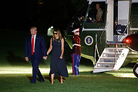 US President Donald J. Trump and First Lady Melania Trump walk from Marine One after arriving on the South Lawn of the White House in Washington, DC, USA, 07 August 2019. President Trump and the First Lady traveled to Dayton and El Paso to meet with shooting first responders, families and victims<br /> CAP/MPI/RS<br /> ©RS/MPI/Capital Pictures